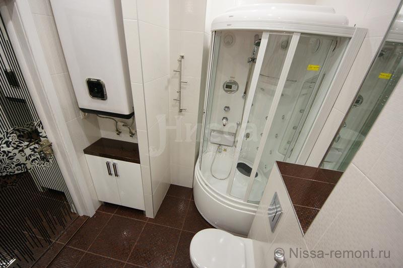 Установка нагревателя и душевой кабины в ванной